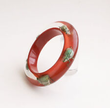 Kolos Designs red lucite bracelet with real insects