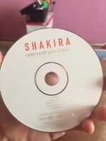 shakira underneath your clothes audio cd