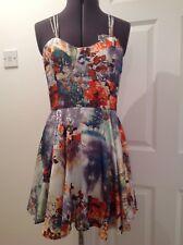 Ladies multi coloured silky fabric strappy dress. Size M/L.