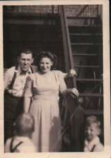 Vintage Family Picture By Stairs Man Sticking out Tongue In Suspenders Photo