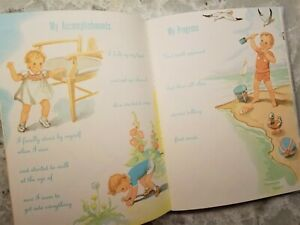 """Vintage (copyright 1943) Baby Book """"Baby's First Years"""" Satin Cover Never Used"""