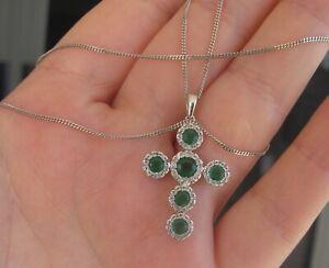 $6,670 Colombian Emerald G/SI Diamonds14k White gold pendant on a chain.