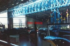 PHOTO  1994 YORK INSIDE THE NRM TO THE LEFT IN THE IMAGE IS A STEAM LOCOMOTIVE W