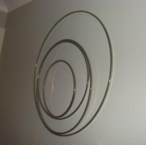 Next eternity sculpture wall art silver metal lovely item looks stunning up