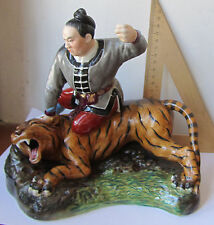 Man with tiger Warrior Chinese porcelain figurine sculpture China Jingdezhen