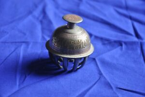 Vintage elephant claw bell silver colour etched with red temple meditation