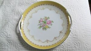 "Noritake ""M"" plate with handles and hand painted gold."