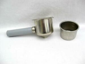 Filter and holder for a coffee machine.  Grounds basket and portafilter