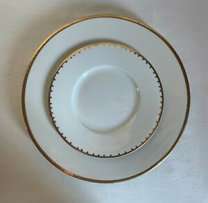 """Crate & Barrel. Two-piece Dinnerware set """"Maison"""" White with gold trim and dots."""
