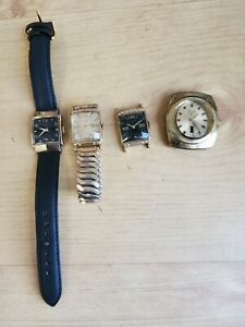 Four Elgin wristwatches: Elgin DeLuxe, Gold fill manual, Black dial, Automatic