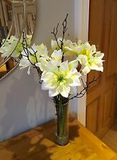 ARTIFICIAL STILL WATER VASE ARRANGEMENT WITH CREAM AMARYLLIS FLOWERS AND TWIGS