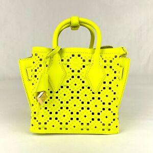 $1390 MCM Neon Yellow Perforated Calfskin Studded Mini Milla Tote MWT9AMA87YN001