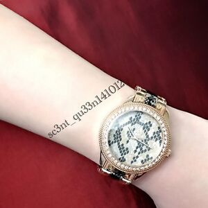 AUTHENTIC GUESS LADIES SERPENTINE WATCH W0624L2 RRP:$479 BRAND NEW