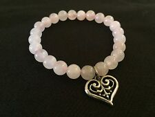 Doreen Virtue's rose quartz silver heart gemstone stretchable bracelet
