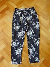 LAURA ASHLEY SIZE 12 POLESTER FLORAL PATTERN TROUSERS  COLOUR BLACK AND WHITE