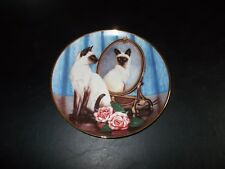 Siamese Twins Plate by Daphne Baxter, Franklin Mint, displayed and stored