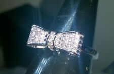 INFINITY BOW RING WITH CREATED WHITE SAPPHIRES SIZE P
