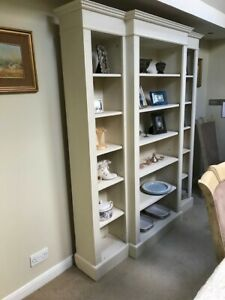 Cream breakfront bookcase with 15 shelves in total