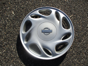 One factory 1996 1997 Nissan Altima 15 inch hubcap wheel cover repaired clips