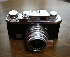 A VINTAGE SMALL HALINA 35X CAMERA WITH ITS ORIGINAL CASE.