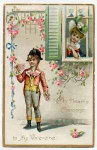 012621 VINTAGE TUCK VALENTINE POSTCARD GIRL WATCHES BOY READ NOTE FROM WINDOW