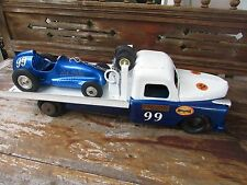 1940's McCoy Nylint tether race car plus 20 in. Structo toy hauler for display
