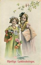 Unposted 1907 Printed Swedish PC Hjertliga Lyckonskningar Girls bring Gifts