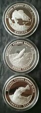 Three North American Fishing Club Proof 1oz Silver Fish Rounds in Capsules