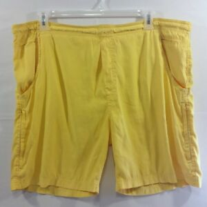 Mens Yellow Swim Trunks Shorts marked Large, measure XL 44 inch Mesh liner