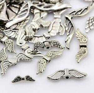 TOP QUALITY ASSORTED TIBETAN SILVER ANGEL WING SPACER BEADS 50gram BAGS TS41