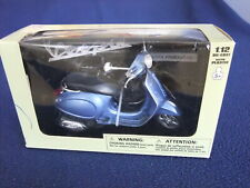 New Ray Vespa Primavera Scooter - 1/12 Scale Met. Blue with Black Seat BOXED