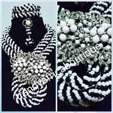 Sale: Black/white beaded necklace set. Beautiful center piece broach. Coral-neck