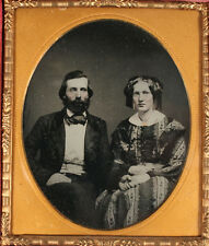 AMBROTYPE COUPLE HOLDING HANDS. TINTED, 1/6 PLATE, AMBER GLASS, FULL CASE.
