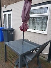 Garden table, 4 chairs, umbrella.Used in very good condition.