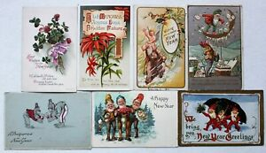 # T2818    NEW YEARS    POSTCARD LOT,   7  DIF. CARDS