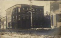 Dolgeville NY Post Office & Street in Winter c1910 Real Photo Postcard