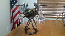 Horseshoe wine rack holds single bottle and two glasses