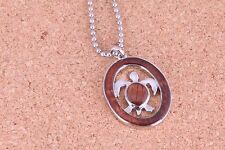 circle turtle pendant with koa wood inlaid 1 inch length chain included