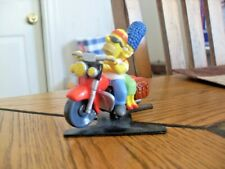 Homer and Marge Simpson on Motorcycle