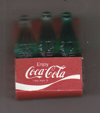 6 MINI  COCA-COLA  BOTTLES IN CARRIER   1 1/2 inches high