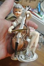 Vintage BONE CHINA LADY WITH CHELLO Figurine w/ 2 ARROWS MARK ON BOTTOM