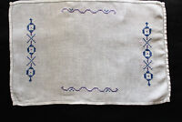 Vintage white linen tray cloth with hand embroidered blue cross stitch pattern.