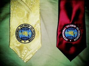 ITF taekwondo ties, one red left and 4 blue.