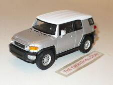 WELLY TOYOTA FJ CRUISER 4.75 INCH LONG SILVER METALLIC PULL BACK FREE SHIP