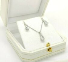 Sterling silver pear cut created diamond pendant necklace and stud earrings