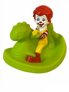 McDonald's Under 3 Happy Meal Toy Baby Ronald on green dragon water float 2006