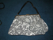 Grey patterned material clasp handbag from Next
