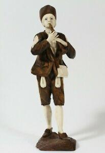 Simon Troger Figur eines Flötenspielers Holz Walnuss Bein Glas  Skulptur