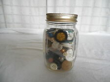 Small glass jar full of old buttons***
