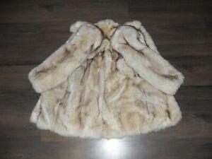 beautiful fur coat made of natural light polar fox fur (not sable, not chinchill